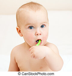 Toddler brushing teeth - Little baby girl with green tooth...