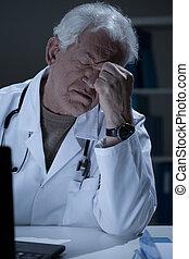 Aged medic having sinus pain at work