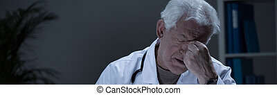 Tired general practitioner - Tired senior general...