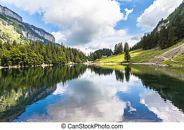 View of Seealpsee lake with reflection of the sky and cloud,...