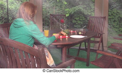 Romantic supper woman - Woman sit near table with burn...