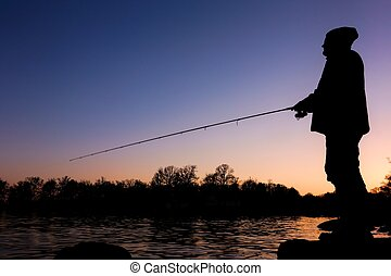 Silhouette of a fisherman - Silhoutte of a sportsfisheman...