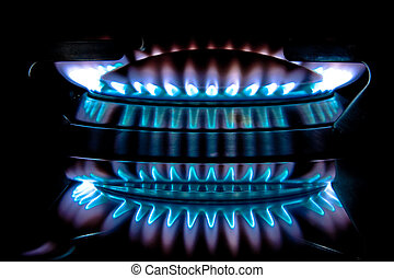 Metano flame on a stove - Blue gas flame on a stove Photo...