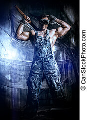 decuman - Handsome muscular coal miner with a hammer over...