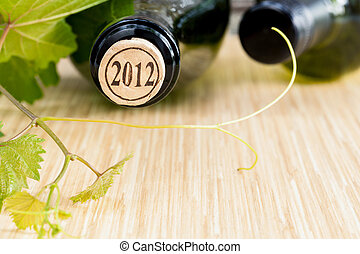 Wine bottle with vine and wine cork put on the board