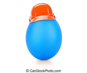 blue egg isolated on white in construction helmet
