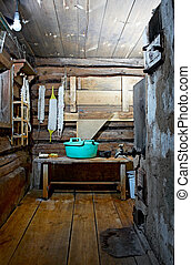 russian rustic bath-house - internal room with stove in...