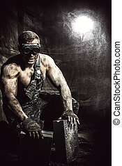 rough labor - Portrait of a strong muscular man coal miner...