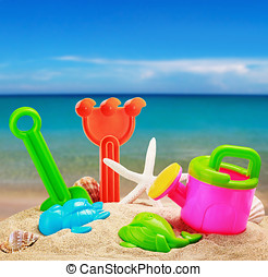 childrens toys in the sand - childrens toys in the sand on...