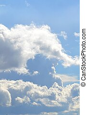 Fluffy clouds with clear blue sky