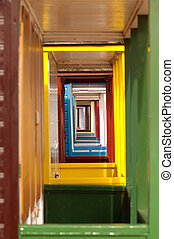vanishing point of colorful beach hut doorways