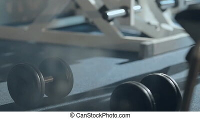 The guy takes the dumbbell from the floor and performs...