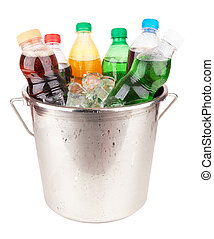 cold beverages in plastic bottles on heap of ice cubes