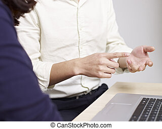 hand gesture of a talking young man - businessman using hand...