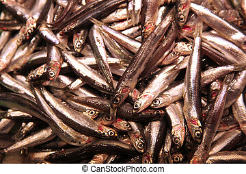 pile of sardinas on foodmarket