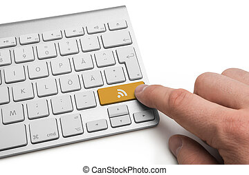 RSS feed icon concept on metallic keyboard