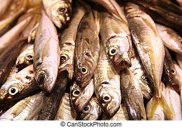 sardinas on food market perspective view - sardinas piled on...
