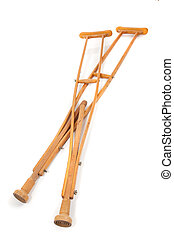 Wooden Crutches - A set of old wooden crutches on a white...