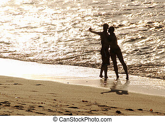 silhouette of lovers on the beach