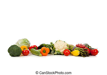 A row of vegetables on white with copy space