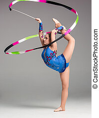 teenager doing gymnastics dance with ribbon - teenager doing...