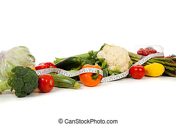 Row of vegetables with a tape on white