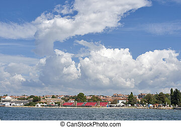 Cloudscape over Porec cityscape in Istria, Croatia.