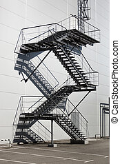 Metal staircase on fire exit at factory - Metal staircase on...