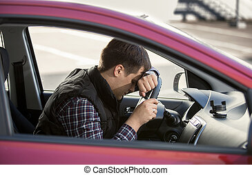 portrait of upset man holding steering wheel - Closeup...