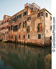 Old Buildings along the Venetian Lagoon in Venice during the...