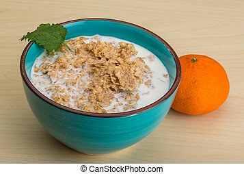 Cornflakes with tangerine and fresh mint leaves