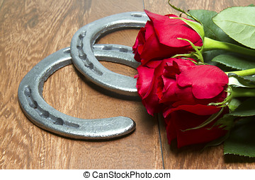Kentucky Derby Red Roses with Horseshoes on Wood - Red Roses...