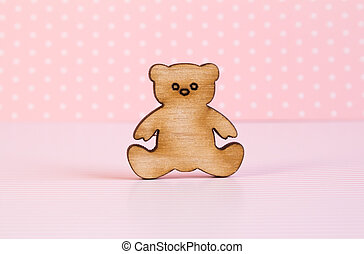 Wooden icon of Teddy bear on pink background