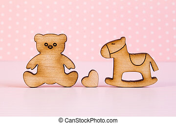 Wooden icons of Teddy bear and childrens rocking horse with...