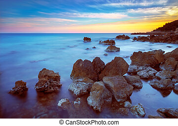 Castiglioncello rock and sea on sunset Tuscany, Italy -...
