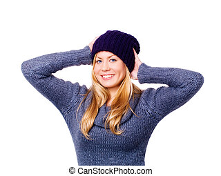 smiling beautiful blond young woman in winter clothes over white