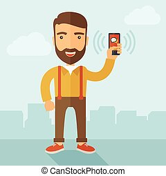 Man holding smartphone. - A man standing while holding...