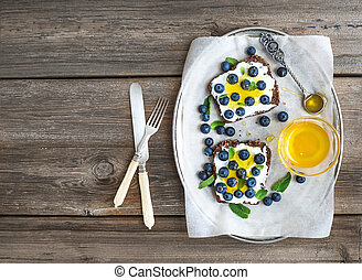 Healthy breakfast set with ricotta, fresh blueberries and...