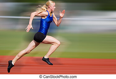 Speed blur - Young athlete running down the track with...