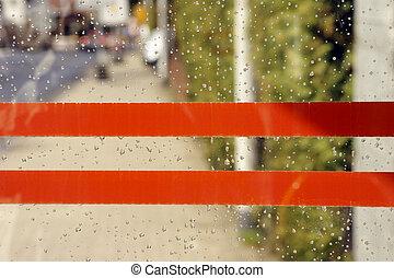 Rainy window with stickers