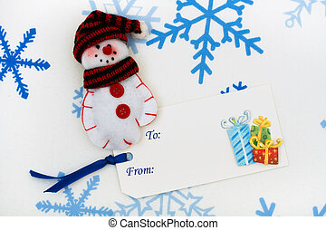 Happy Holidays - A snowman mitten sitting together with a...