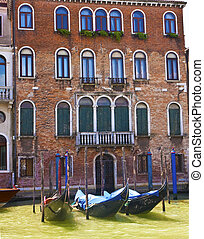Gondolas at Brick Building - Gondolas and buildings along...