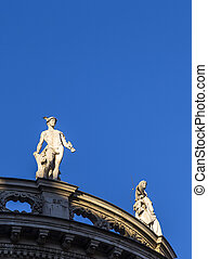 sandstone statues at the roof of an old building at Max...