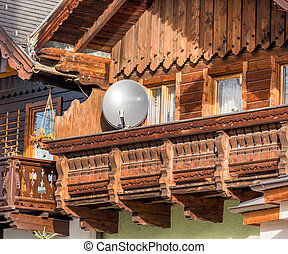traditional house with parabolic antenna