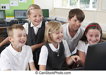 Group Of Elementary Pupils In Computer Class