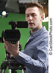 Male Camera Operator In Television Studio