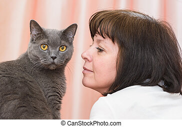 brunette woman with a British cat - middle-aged woman...