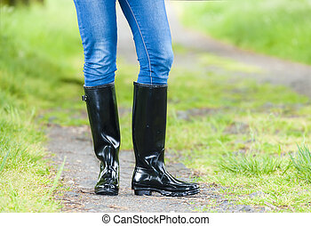 detail of standing woman wearing rubber boots
