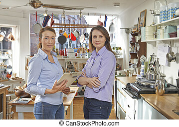 Portrait Of Two Women Running Cook Shop Together