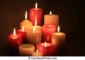 group of burning candles - A group of burning candles,...